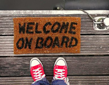 "A mat reading ""welcome on board"""