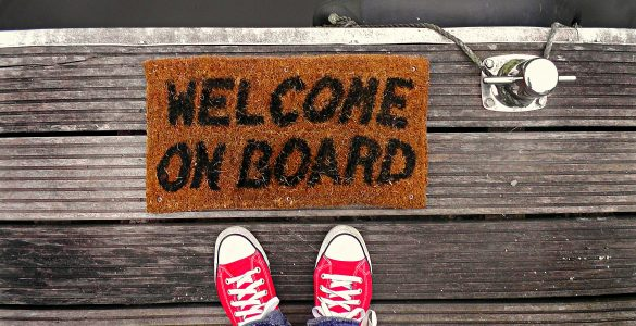 """A mat reading """"welcome on board"""""""